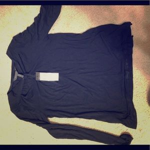 This is a black long sleeves With a neck design
